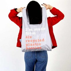 woman holding recycle print shopping bag