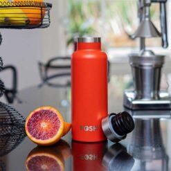 vital red water bottle on kitchen side