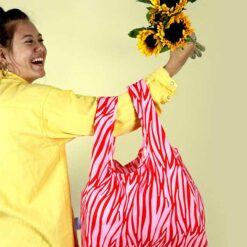 reusable bag over a woman's arms
