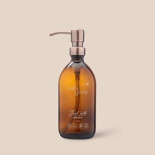 bronzed pump glass bottle