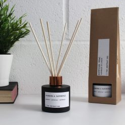 jasmine and patchouli reed diffuser next to packaging