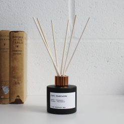 pink fizz reed diffuser in glass bottle