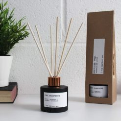 pink fizz reed diffuser next to packaging