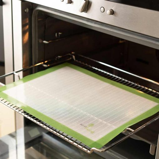 reusable baking sheet on a tray in the oven