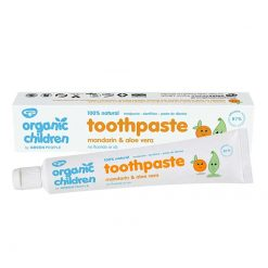 organic toothpaste for children next to packaging