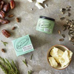 soothing body cream next to fresh ingredients