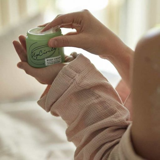 woman holding soothing body cream