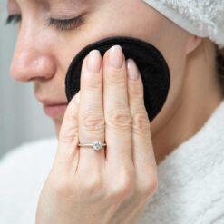 woman using reusable facial wipes