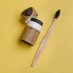 charcoal toothsoap next to bamboo toothbrush