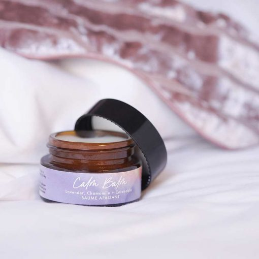 calm balm on bed sheets
