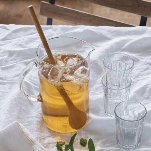 bamboo tasting spoon inside a glass jug