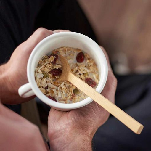 long handle bamboo spoon inside a cup