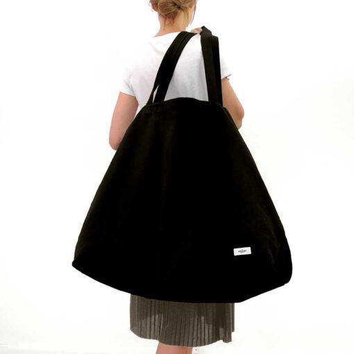 woman holding organic cotton weekend bag