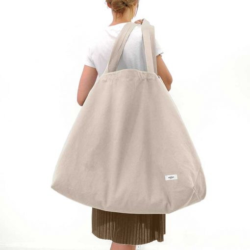 large organic bag over womans shoulder