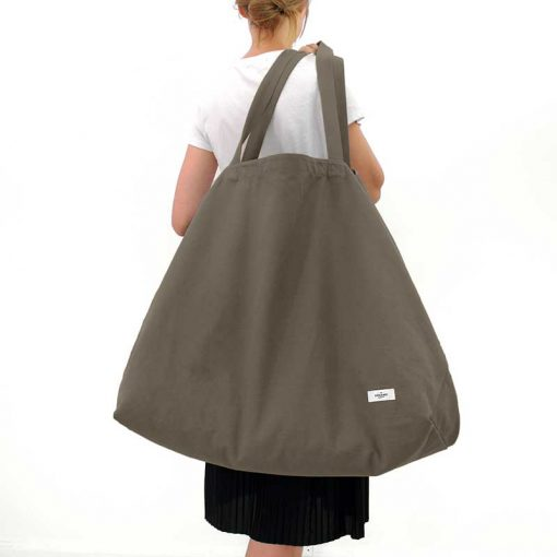 woman carrying extra large cotton bag