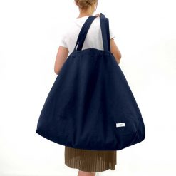 woman carrying a weekend travel bag