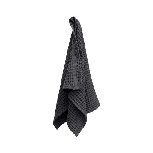 organic cotton hand towel in grey hanging up