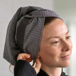 woman with an organic cotton hair towel
