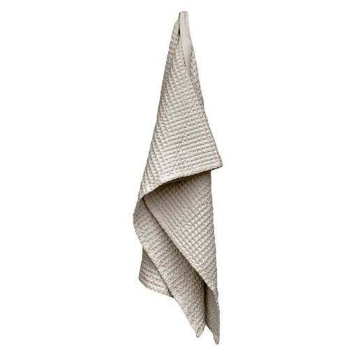 waffle hand towel hanging from a hook