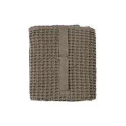 clay bath towel folded up