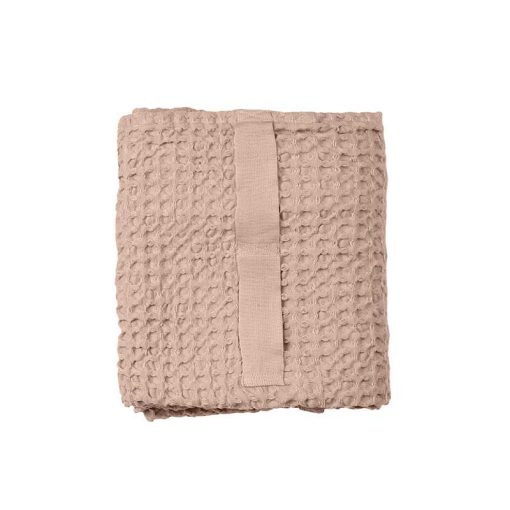 pink hand towel folded up