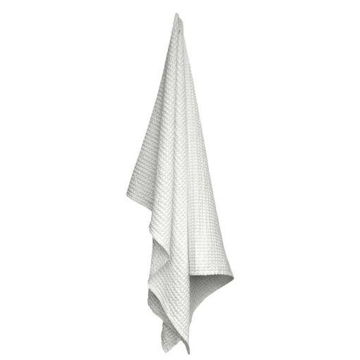 white waffle towel hanging up