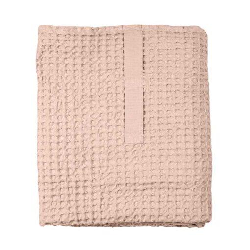 pink waffle bath towel folded up