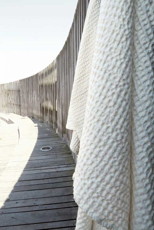large waffle towel and blanket hanging outside