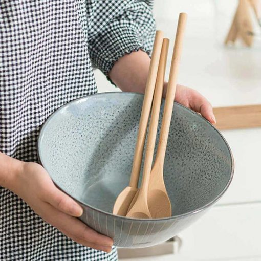 bamboo utensils in a bowl