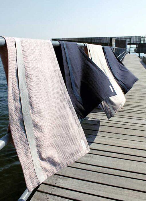 the organic company wellness towel hanging on a washing line