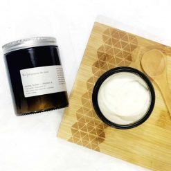 natural cocoa butter in glass jar