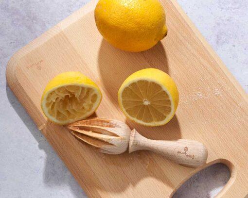 lemon on a wooden chopping board