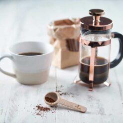 wooden coffee scoop on kitchen side