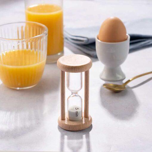 wooden egg timer on kitchen worktop