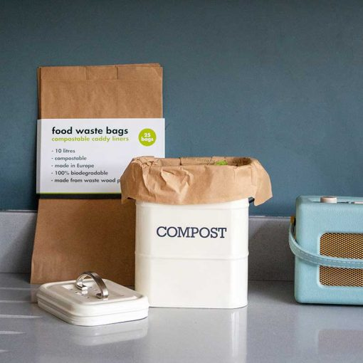 compostable food waste bags next to bin