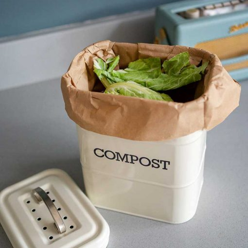compostable food waste bag inside a small compost bin