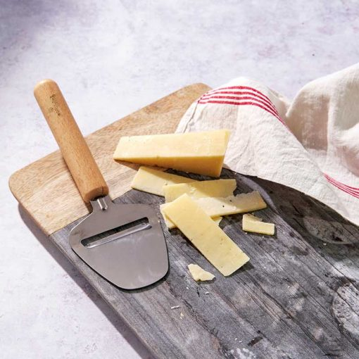 wooden cheese slicer on a chopping board
