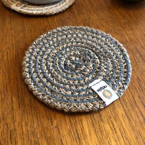grey natural coaster on a table top