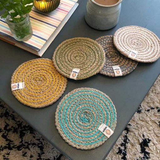 collection of jute coasters on a coffee table