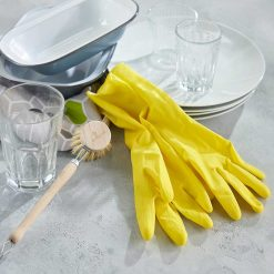 natural latex rubber gloves next to sink area
