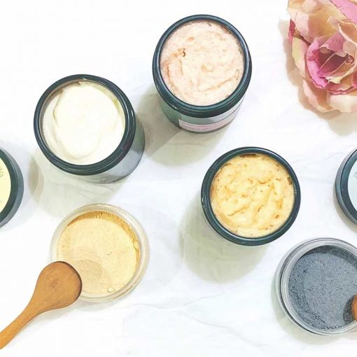 natural cocoa butter and scrubs on a worktop