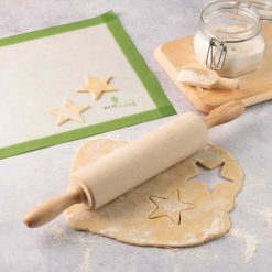 wooden rolling pin on a kitchen worktop