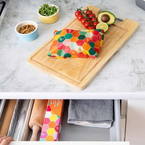 beeswax wraps on a roll on a chopping board
