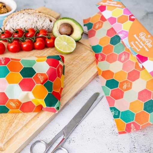 beeswax wraps on a roll next to avocado