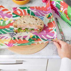 sandwich being wrapped inside vegan wax wrap