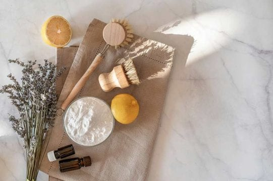 diy natural cleaning products on a table spread