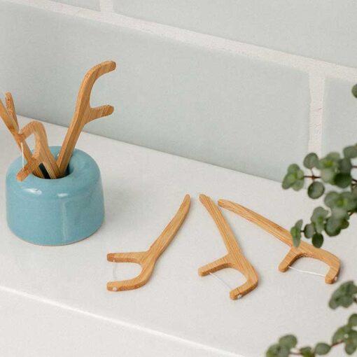 eco friendly floss sticks next to sink