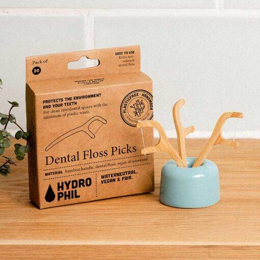 eco friendly floss sticks in a bathroom
