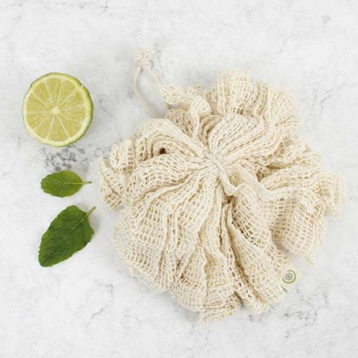 organic cotton body puff next to a lime