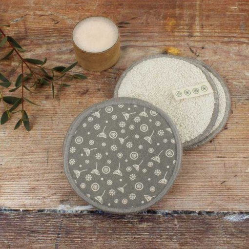 organic cotton facial pads on a wooden table